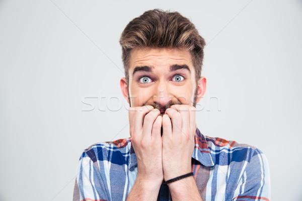 Ritratto paura uomo guardando fotocamera isolato Foto d'archivio © deandrobot