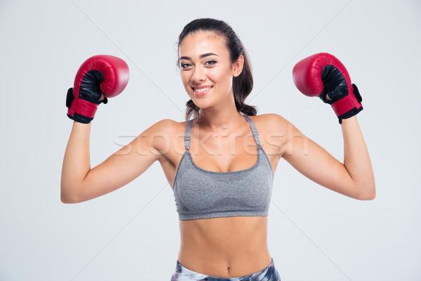 フィットネス女性 立って ボクシンググローブ 勝利 ポーズ 肖像 ストックフォト © deandrobot