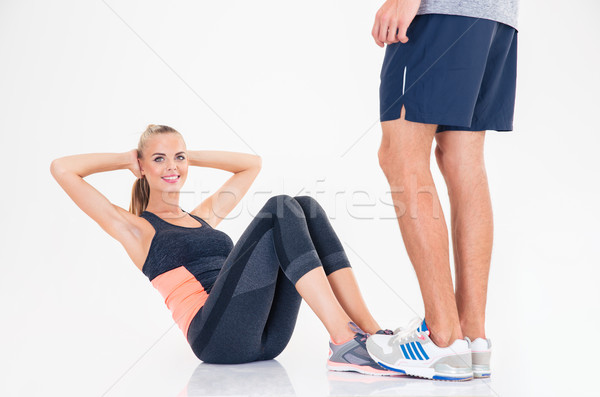 Woman doing abs exercises Stock photo © deandrobot