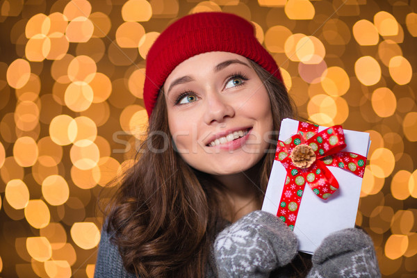 Inspired lovely girl holding blank cards with red ribbon  Stock photo © deandrobot