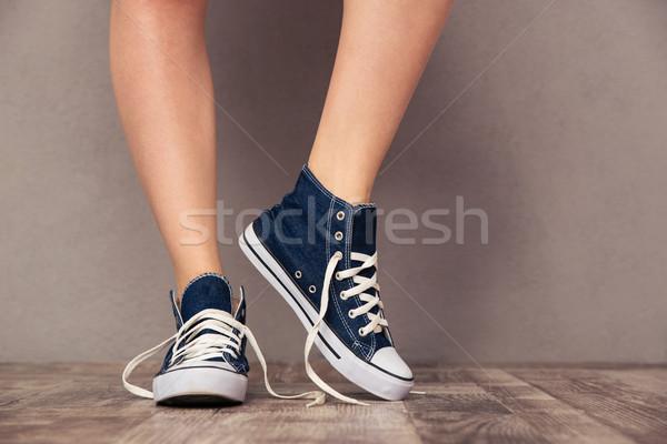 Human legs in sneakers Stock photo © deandrobot