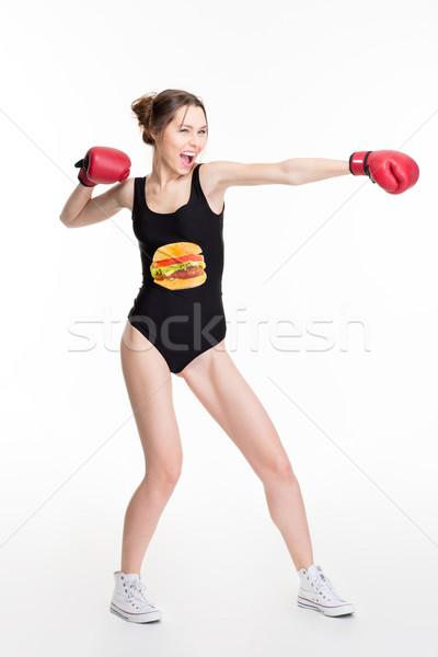 Podniecony funny młoda kobieta rękawice bokserskie kierować Zdjęcia stock © deandrobot