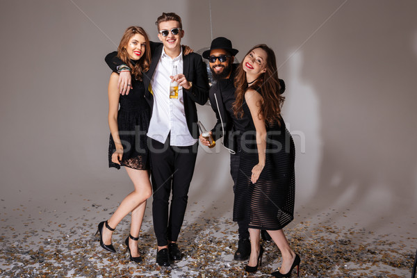 Two beautiful young couples standing and hugging  Stock photo © deandrobot