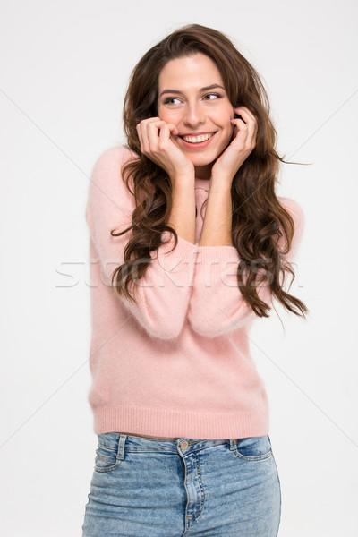 Feliz bonitinho mulher posando isolado branco Foto stock © deandrobot