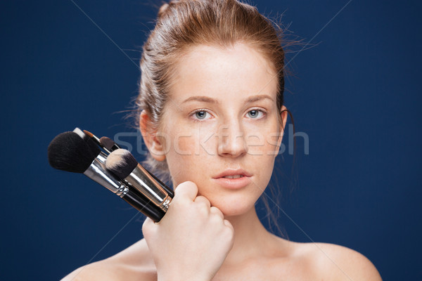 Young woman holding makeup brushes  Stock photo © deandrobot