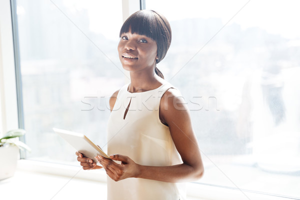 Businesswoman holding tablet compute Stock photo © deandrobot