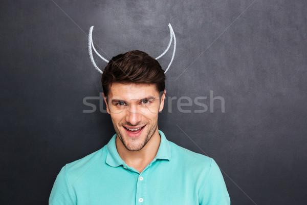 肖像 笑みを浮かべて 若い男 悪魔 ストックフォト © deandrobot