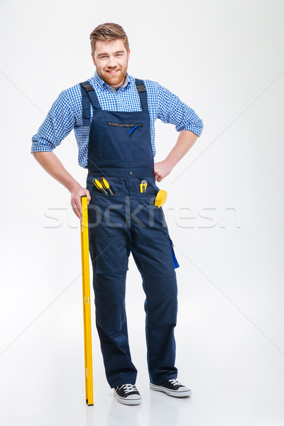 Full length portrait of a happy male builder Stock photo © deandrobot
