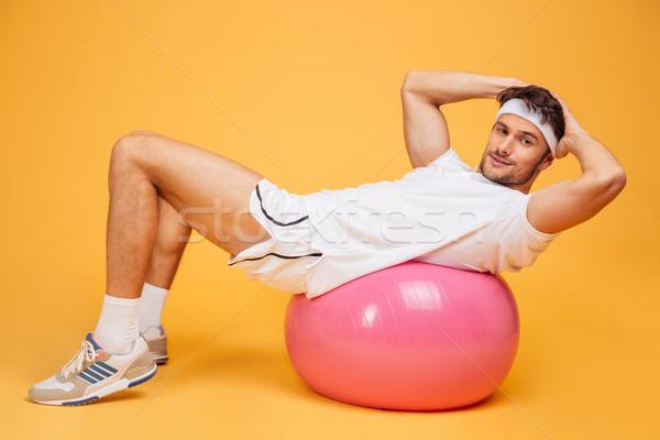 Sportler Fitness Ball orange jungen gut aussehend Stock foto © deandrobot
