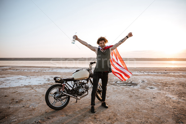 Stock photo: Man in american flag cape with hands up in air