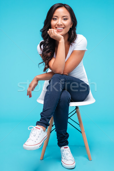 Attractive young vietnamese woman sitting on the chair Stock photo © deandrobot