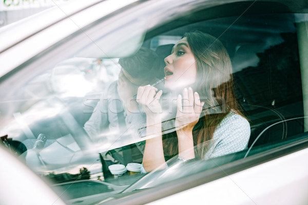 Side portrait of couple in car Stock photo © deandrobot