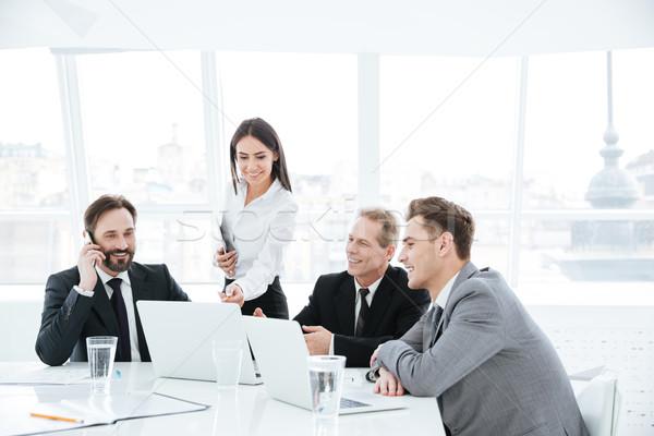 üzleti csoport asztal ablak ül konferenciaterem megbeszélés Stock fotó © deandrobot