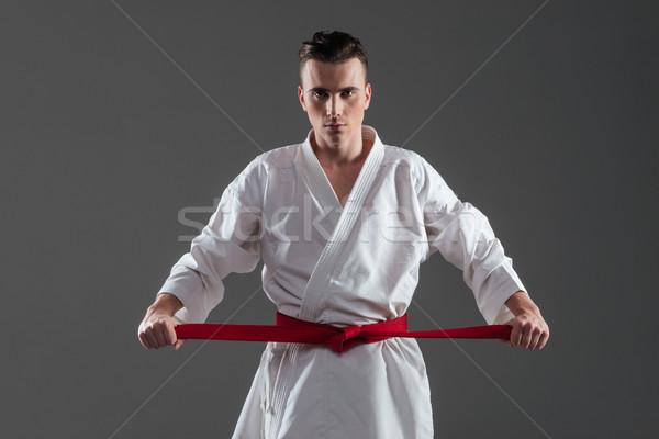 Młodych sportowiec kimono czerwony pasa zdjęcie Zdjęcia stock © deandrobot