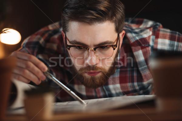 Koncentrált szakállas designer dolgozik éjszaka kép Stock fotó © deandrobot