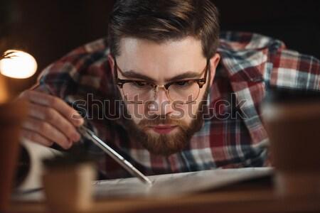Zagęszczony młody człowiek obiektyw Zdjęcia stock © deandrobot