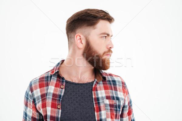 серьезный бородатый человека рубашку Сток-фото © deandrobot