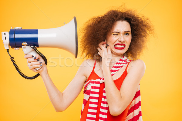 Brilhante modelo megafone mulher isolado laranja Foto stock © deandrobot