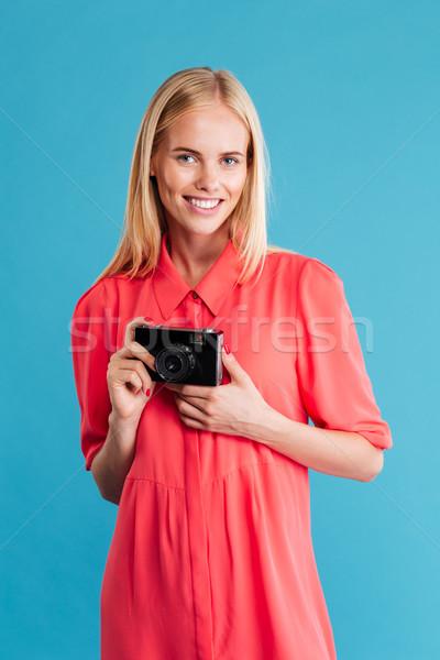 Retrato sorridente mulher loira retro câmera Foto stock © deandrobot