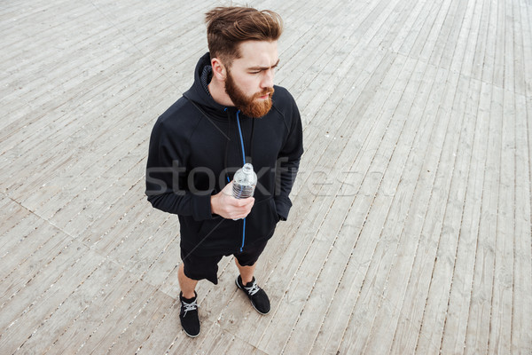From above image of runner with water Stock photo © deandrobot