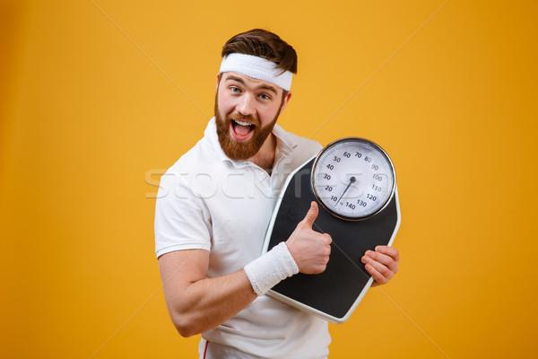 Szczęśliwy podniecony brodaty fitness człowiek Zdjęcia stock © deandrobot