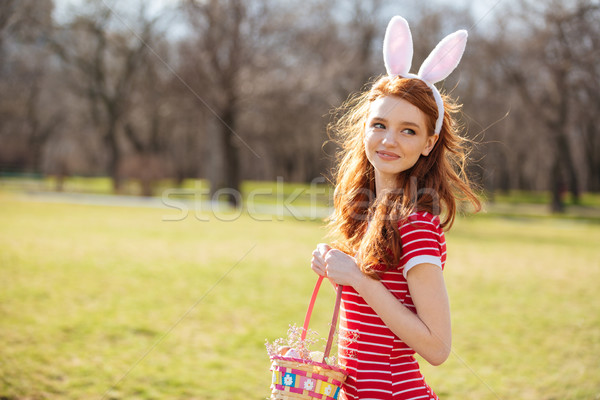 Portrait of a smiling cute red head girl Stock photo © deandrobot