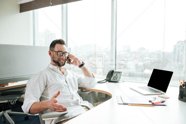 Smiling Man in shirt talking on phone Stock photo © deandrobot
