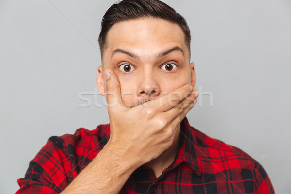 Close up portrait of Shocked man covering his mouth Stock photo © deandrobot