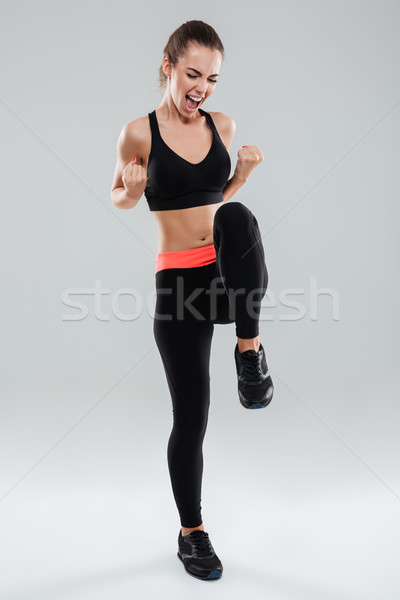 Full length image of So happy screaming fitness woman Stock photo © deandrobot