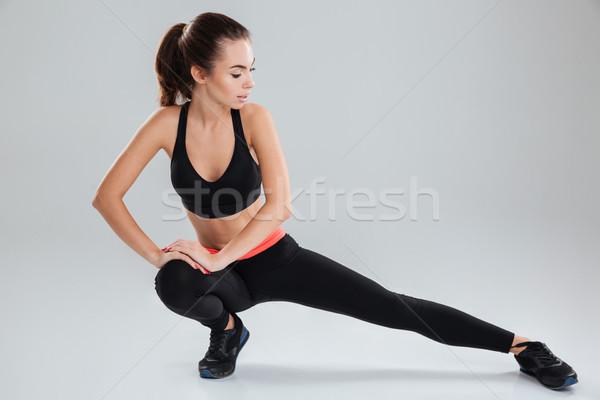 小さな フィットネス女性 ストレッチング 脚 グレー スポーツ ストックフォト © deandrobot