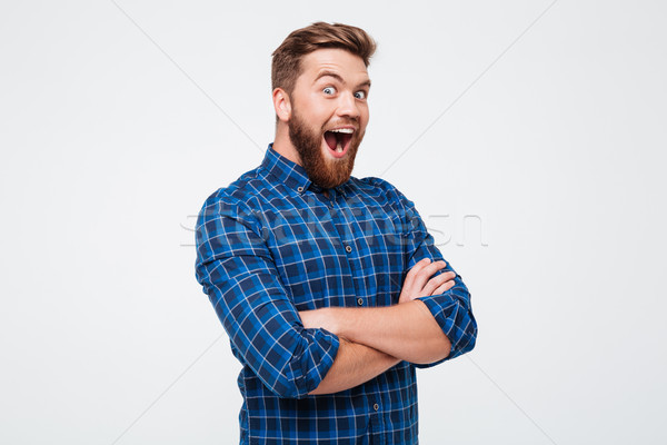 Happy man smiling with opened mouth isolated over white Stock photo © deandrobot