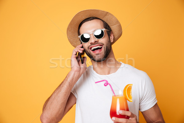 Stock photo: Cheerful young man standing isolated