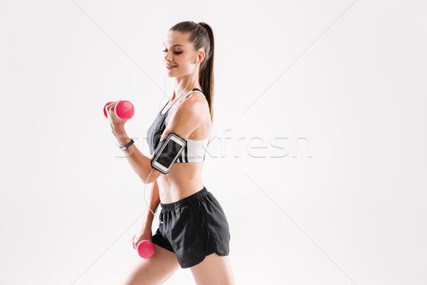 Portré boldog fitnessz nő sportruha zenét hallgat fülhallgató Stock fotó © deandrobot