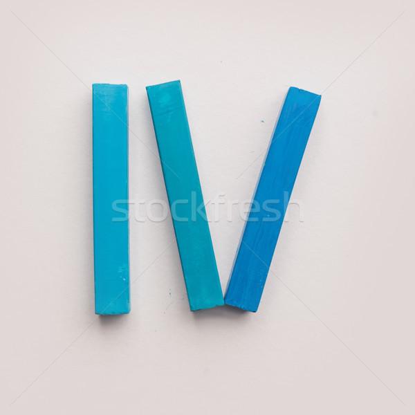 Quatro peças azul pastel crayon isolado Foto stock © deandrobot