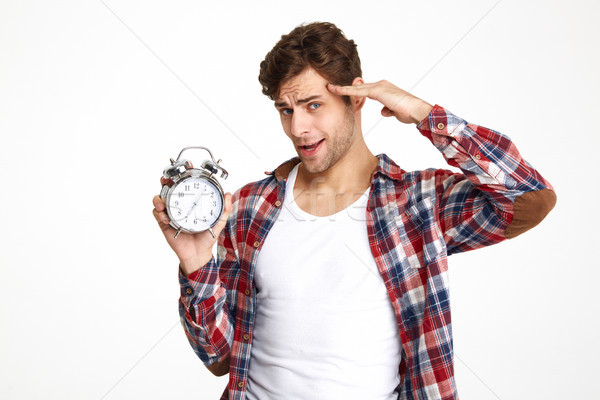 Portrait of a handsome casual man with hand at head Stock photo © deandrobot