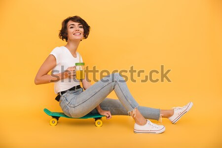Portrait of a cheery young girl sitting record player Stock photo © deandrobot