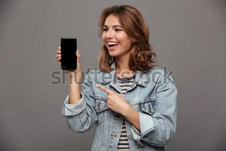 смешные подростка девушка джинсов куртка мира Сток-фото © deandrobot