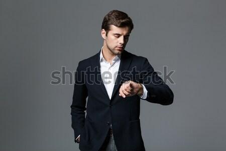 Portre genç sakallı işadamı siyah takım elbise Stok fotoğraf © deandrobot