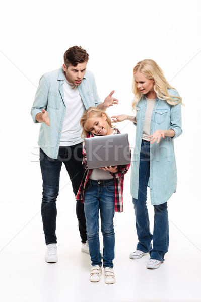 Full length portrait of an irritated family Stock photo © deandrobot