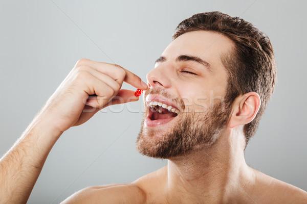 портрет счастливым человека красный капсула Сток-фото © deandrobot