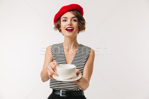 Portrait of n excited woman wearing red beret Stock photo © deandrobot