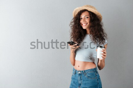Portrait of intellectual female student with backpack being educ Stock photo © deandrobot