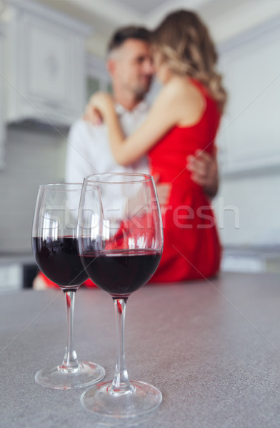 Close up of glasses with wine on table Stock photo © deandrobot