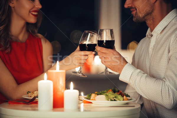 Cropped photo of lovers having romantic dinner at home Stock photo © deandrobot