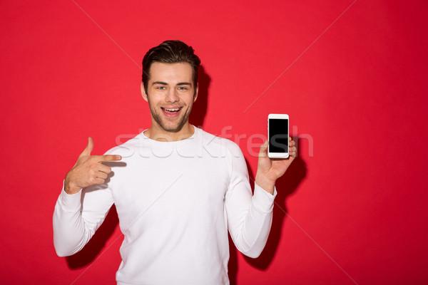 Foto felice uomo maglione guardando fotocamera Foto d'archivio © deandrobot