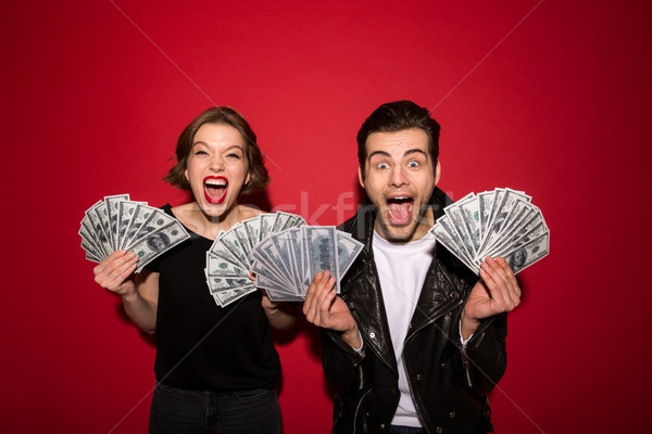 Happy screaming punk couple posing with money and rejoice Stock photo © deandrobot