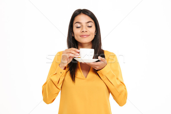 Portrait of a lovely young woman smelling tea cup Stock photo © deandrobot