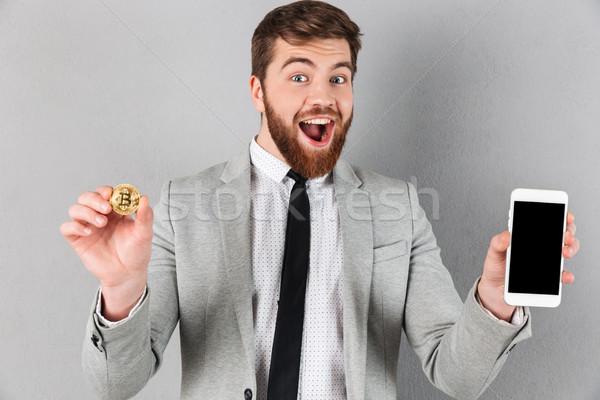 Portrait excité affaires bitcoin Photo stock © deandrobot