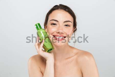 Beauty portrait of pleased dark-haired woman with clean healthy  Stock photo © deandrobot