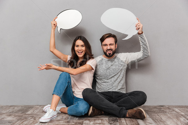 Portrait of a frustrated young couple Stock photo © deandrobot